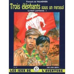 Trois éléphants sous un parasol